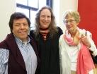 Graduating MLIS student Erika Kirsch with family.