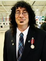 Jerry Fielden, MLIS'02, receiving a Queen Elizabeth II Diamond Jubilee Medal.